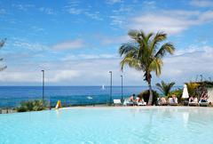 swimming pool and beach at luxury hotel, tenerife island, spain - stock photo