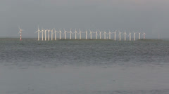 Timep lapse of turbines from wind farm on waters edge Stock Footage