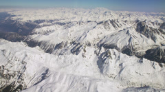 Aerial tracking shot of snow covered Alps 2/7 -0007 - stock footage
