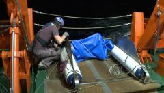Preparing the Neuston net on the night shift Stock Footage