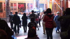 People praying with incense in Taoist temple. Taipei Stock Footage