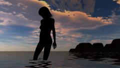 Woman on the beach in sunset - nude silhouette Stock Footage