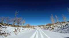 POV road trip driving snowy landscape vehicle extreme climate snow Zion Utah USA - stock footage