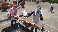 Roasting a goat in the memorial hall. Taipei Stock Footage
