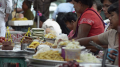 ASIA MARKET: Medium telephoto shot of  and sellers Stock Footage