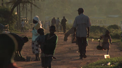 People in a kenyan dirt road Stock Footage
