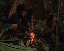 Punans, cooking hunted food Stock Footage