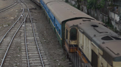 TRAIN - LOCOMOTIVE: Overhead medium shot of train passing below Stock Footage