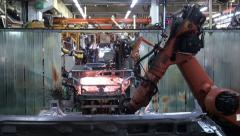 Car factory. Robotic arm making car in line Stock Footage