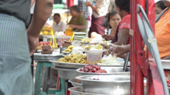 ASIA MARKET: Wider side view of market seller food trays Stock Footage