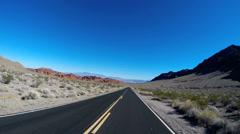 POV drive sandstone desert Valley of Fire blue winter landscape Nevada USA - stock footage