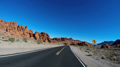 POV Valley of Fire Road drive desert blue sky winter Interstate 15 State Park Stock Footage