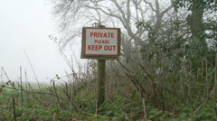 KEEP OUT sign in the mist (dolly out & in) wide Stock Footage