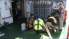Scientist collecting water in rosette CTD - stock footage