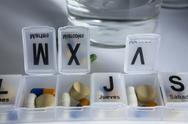 Stock Photo of pills with pill organizer