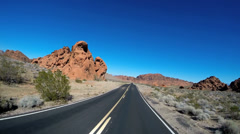 Stock Video Footage of POV vehicle driving Wilderness remote winter Valley of Fire Road Interstate 15