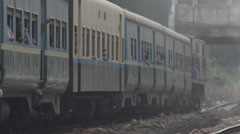 TRAIN LOCOMOTIVE: Telephoto shot of wrinkly hazy train departing - stock footage
