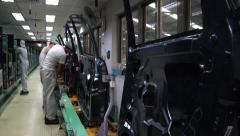 Car factory. Workers making a car door - stock footage