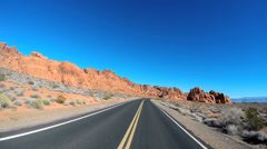 POV vehicle driving Wilderness remote winter Valley of Fire Road Interstate 15 Stock Footage