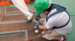 Scientific taking samples of an ocean microorganisms from a Bongo nets Stock Footage