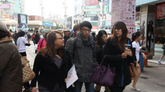 Street view of ximending with mrt in background Stock Footage