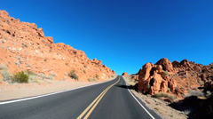 POV road driving Valley of Fire State Park extreme terrain sandstone Nevada USA Stock Footage