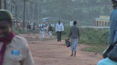 People in a kenyan dirt road and chicken Stock Footage