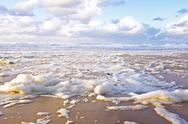 Stock Photo of ocean foam at the beach