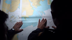 Marines tracing a route with charts in the Hesperides, A-33 Stock Footage