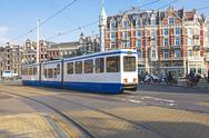 Stock Photo of tram driving in amsterdam the netherlands