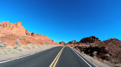 POV road drive desert landscape Valley of Fire Indian Reservation Nevada USA Stock Footage
