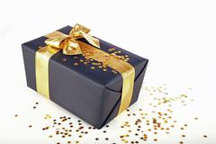 christmas present with golden ribbon - stock photo