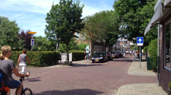 dutch street live cycling in summer in 1080p - stock footage