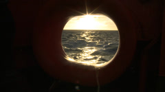 Sunset in Atlantic Ocean, porthole of the Hesperides A-33 Stock Footage