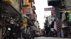 A very low angle shot in a lane near the shilling night market Stock Footage