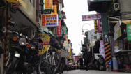 Stock Video Footage of a very low angle shot in a lane near the shilling night market