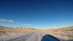 POV driving road trip Monument Valley winter snow climate blue Utah USA - stock footage