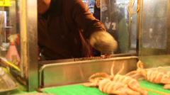 Stock Video Footage of night market scene with vendor serving fresh squid