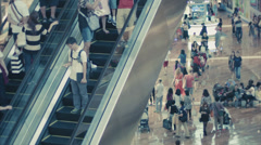 Singapore - dec 31 2013: a crowd on the escalator in the shopping area of mar Stock Footage