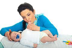 Mother caress her newborn baby - stock photo