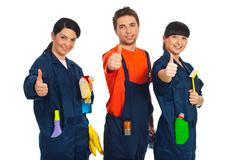 Cleaning workers giving thumbs up - stock photo