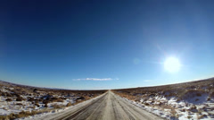 POV vehicle driving road Monument Valley winter snow  blue Utah USA Stock Footage