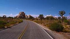 Pov driving through Joshua Tree's Hidden Valley 4K Stock Footage