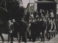 Prisoners coming out from barracks Stock Footage