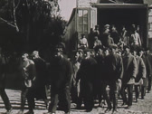 Stock Video Footage of prisoners coming out from barracks