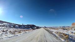 POV road driving desert winter  snow Colorado Plateau Monument Valley Arizona - stock footage