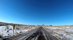 POV driving road Monument Valley winter landscape snow climate Arizona Utah USA Stock Footage