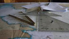 Navigation letters, bevel, compass and map in boat - stock footage