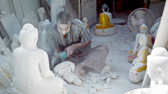 Mandalay, myanmar - 13 jan 2014: covered by dust of marble stone carver make Stock Footage