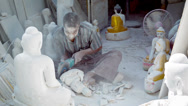 Stock Video Footage of mandalay, myanmar - 13 jan 2014: covered by dust of marble stone carver make